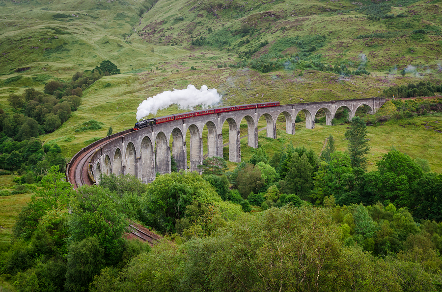 Steam Train On A Famous Glenfinnan Viaduct, Scotland